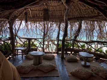 Private shaded sitting area overlooking the ocean at Kanan